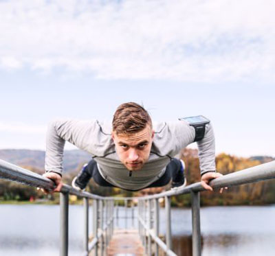 An athlete moving across a bridge