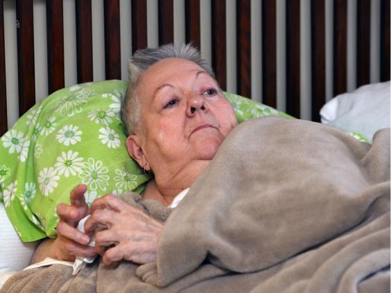 Carolyn Boismier lying in her bed