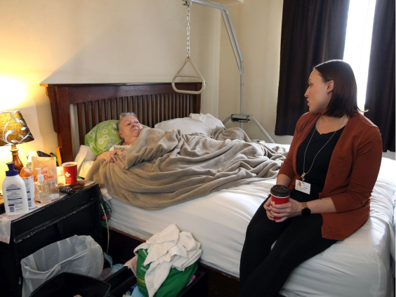 Carolyn Boismier receiving a visit from Kari Tofflemire