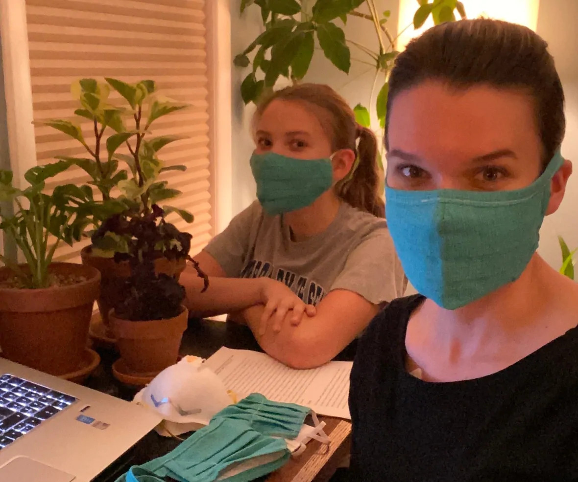Karen and Sarah Harris wearing blue facemasks