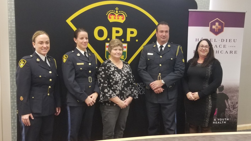Representatives of Hotel-Dieu Grace Healthcare stand with OPP Officers
